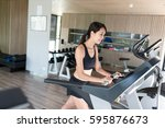 woman running on treadmill | Shutterstock . vector #595876673