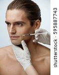 male beauty injection. portrait ... | Shutterstock . vector #595887743