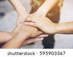 people hand assemble corporate... | Shutterstock . vector #595903367