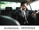 confident young businessman... | Shutterstock . vector #595935563