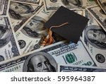 miniature graduation cap on... | Shutterstock . vector #595964387