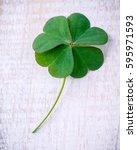 clover leaves on wooden... | Shutterstock . vector #595971593