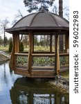 A Wooden Gazebo On The Lake In...