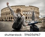 woman tourist near the coliseum ... | Shutterstock . vector #596056967