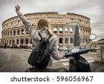 woman tourist near the coliseum ... | Shutterstock . vector #596056967