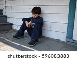 unhappy neglected child outside ... | Shutterstock . vector #596083883