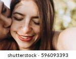 sensual couple embracing.... | Shutterstock . vector #596093393
