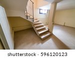 staircase to basement room. | Shutterstock . vector #596120123