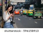 asian backpacker woman using... | Shutterstock . vector #596158913