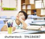 asian elementary schoolboy... | Shutterstock . vector #596186087