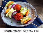 halloumi cheese and vegetables... | Shutterstock . vector #596259143