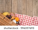 picnic basket with fruits ... | Shutterstock . vector #596357693