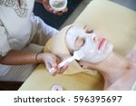 a day in the spa   face... | Shutterstock . vector #596395697