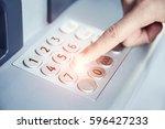 dialing password at atm | Shutterstock . vector #596427233