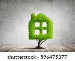 house shaped green tree as real ...