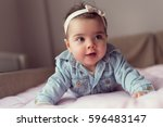beautiful baby girl crawling... | Shutterstock . vector #596483147
