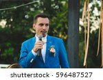 groom holding microphone and... | Shutterstock . vector #596487527