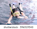 young woman swimming underwater ...   Shutterstock . vector #596519543