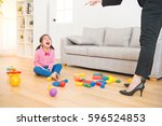 Small photo of business woman back from office and see her daughter play toys messy up the living room feel angry and criticize the sadness asian kid girl at home.