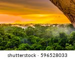 sunset over the trees in the... | Shutterstock . vector #596528033