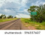 Small photo of Texas Stateline sign next to historic Route 66 near the town of Texola, Oklahoma