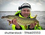 sea pike fishing in winter | Shutterstock . vector #596605553