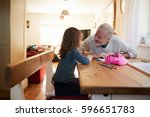 grandfather and granddaughter... | Shutterstock . vector #596651783