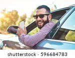 happy male driver smiling while ...   Shutterstock . vector #596684783