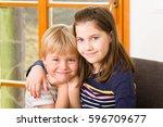 girl hugging boy  lovely kids... | Shutterstock . vector #596709677
