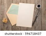 envelope  ink pen  inkwell on a ... | Shutterstock . vector #596718437