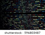 java script code on black... | Shutterstock . vector #596803487
