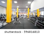 weights in a fitness hall  | Shutterstock . vector #596816813