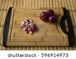 red onions chopped on chopping... | Shutterstock . vector #596914973