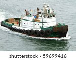 Tug Boat Traveling Through The...