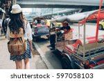 woman tourist walking in busy... | Shutterstock . vector #597058103
