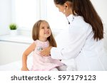 doctor examining a little girl... | Shutterstock . vector #597179123