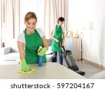 housekeeping team cleaning room | Shutterstock . vector #597204167