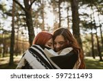 two young women embracing under ... | Shutterstock . vector #597211493