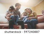 happy family at home spending... | Shutterstock . vector #597240887