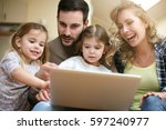 happy family spending time at... | Shutterstock . vector #597240977