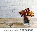 vase of colorful flower on wood ... | Shutterstock . vector #597243383