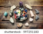 Small photo of Multiple semi precious gemstones on wooden board fluorite, quartz, obsidian, rose quartz and many other