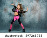 young girl break dancing on... | Shutterstock . vector #597268733