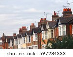 row of typical modern britain... | Shutterstock . vector #597284333