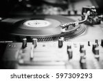 dj turntable vinyl record... | Shutterstock . vector #597309293