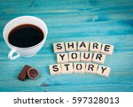 Small photo of share your story. Coffee mug and wooden letters on wooden background