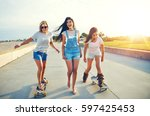 three active pretty young woman ... | Shutterstock . vector #597425453