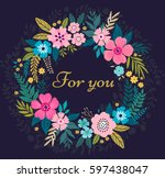 floral wreath on dark blue... | Shutterstock .eps vector #597438047
