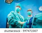 orthopedic surgeons portrait in ... | Shutterstock . vector #597472307