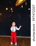 little boy in white shirt  red... | Shutterstock . vector #597472337